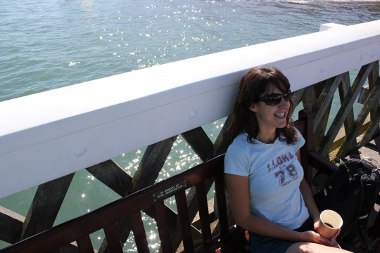 Bryony having coffee on a bench on Yarmouth Pier