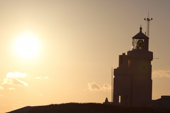 Lighthouse silhouette, with setting sun