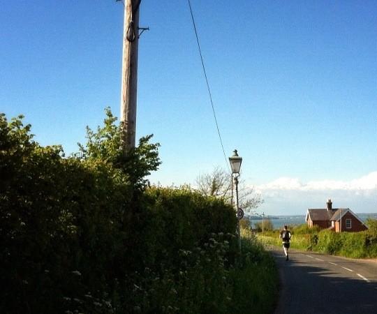 Tom running away down a lane