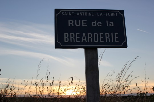 French signpost to Rue de la Brearderie at sunset