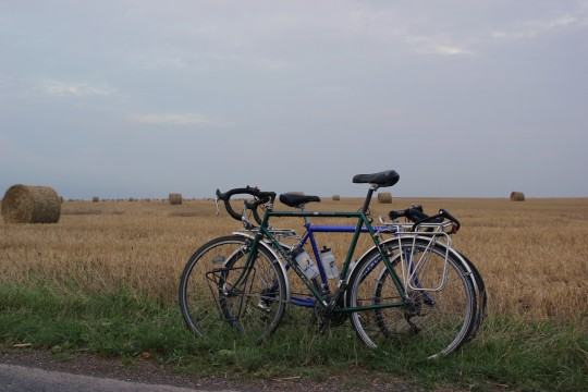 Dawes and Pinarello bikes together by hay bales