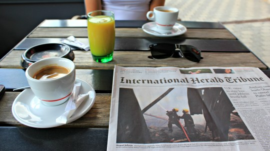 International Herald Tribune paper on a table at cafe