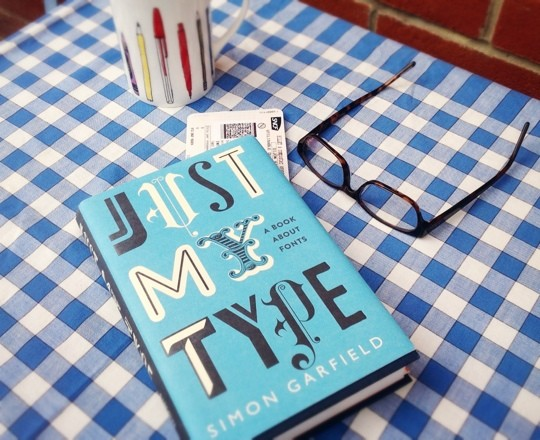 Just My Type book on a table with glasses and mug
