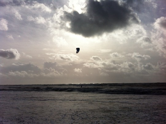 Kite surfer on stormy day at Brook Chine