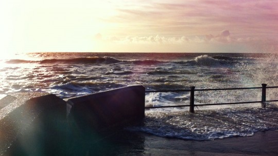 Sea wall with stormy seas