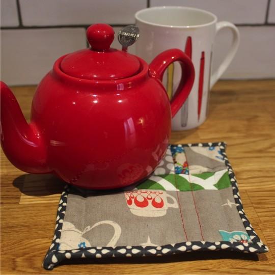 Tea pot on a tea trivet