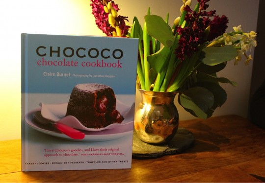 Chococo book next to flowers