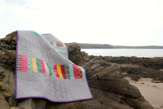 Quilt on rocks at the beach