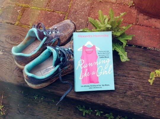 Muddy running shoes and book