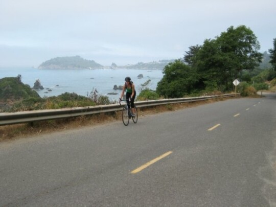 Rusty cycling with Trinidad Head in the background