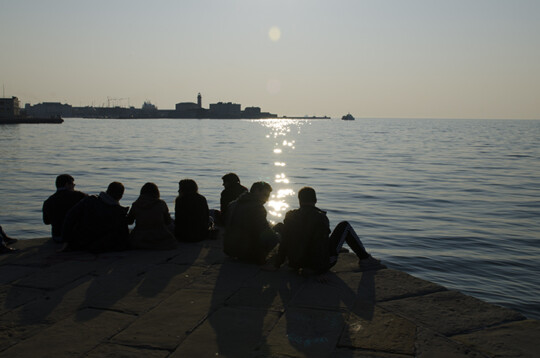 People sitting by the sea