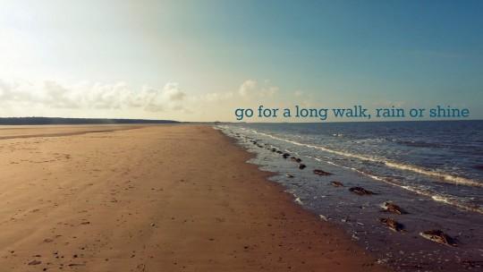 "Hunstanton beach with text ""Go for a long walk, rain or shine"""