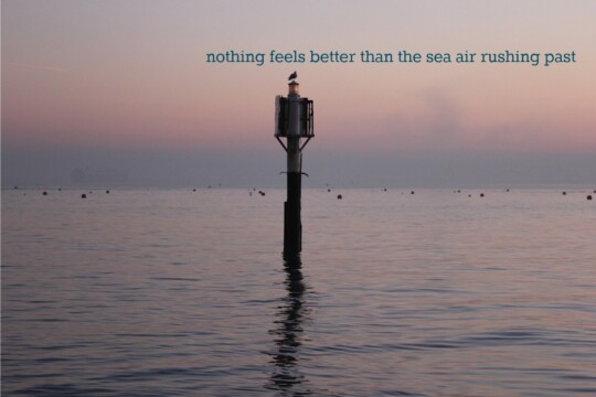 "Sea marker with text ""nothing feels better than the sea air rushing past"""