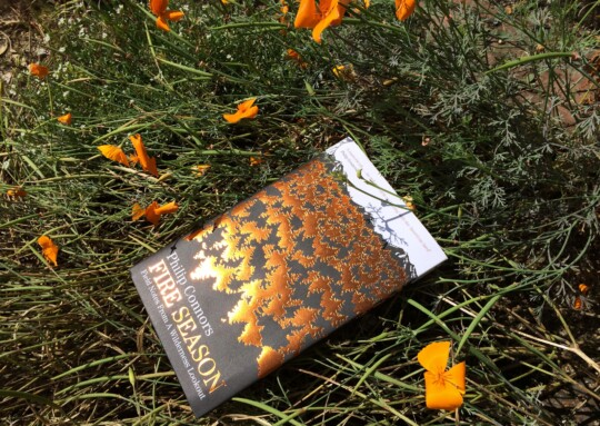 Fire Season book amongst flowers