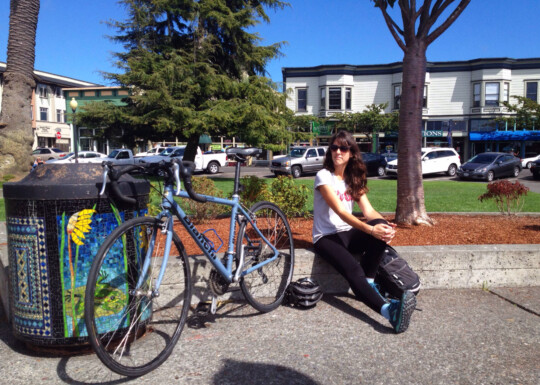 Rusty sitting by a bike at Arcata Plaza