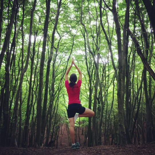 Rusty performing Tree Pose, yoga in the forest
