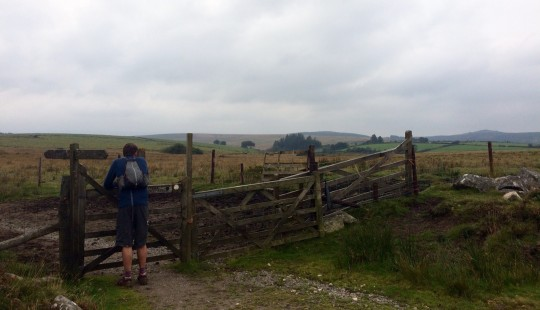 Tom standing at a moorland gate